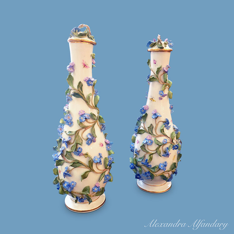 A Pair Of Meissen Vases And Lids With Applied Forget Me Not Flowers